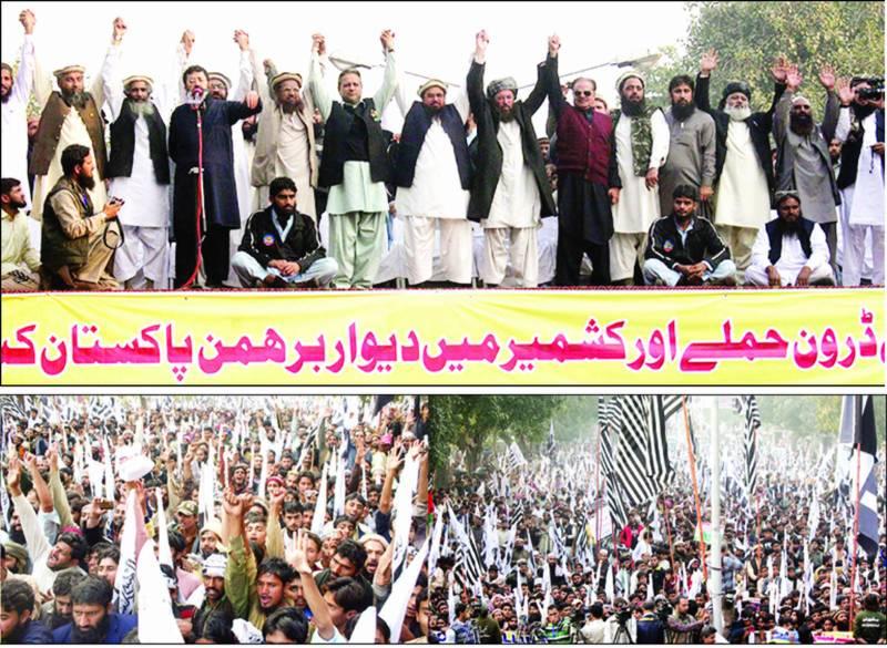 لاہور: مال روڈ پر دفاع پاکستان کونسل کے کارکن جھنڈے اٹھائے ڈرون حملوں کیخلاف احتجاج اور حکومت سے ایکشن لینے کی اپیل کر رہے ہیں، دوسری طرف مولانا سمیع الحق 'حافظ محمد سعید، جنرل (ر) حمید گل، سردار عتیق احمد، اختر رسول قادری، مولانا فضل الرحمن خلیل، عبدالرئوف فاروقی اور دیگرہاتھ اٹھا کر یکجہتی کا مظاہرہ کررہے ہیں