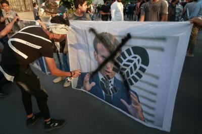 فرانس: توہین آمیز خاکوں کی اشاعت کے خلاف فلسطینی پناہ گزینوں کے مظاہرے