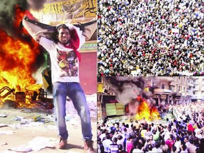 اختیارات سمیٹنے پر مرسی کے خلاف ہزاروں افراد کا تحریر سکوائر پر دھرنا' اخوان کے کئی دفاتر نذر آتش