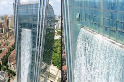 چین کی 100 میٹر بلند عمارت سے آبشار بہنے لگی